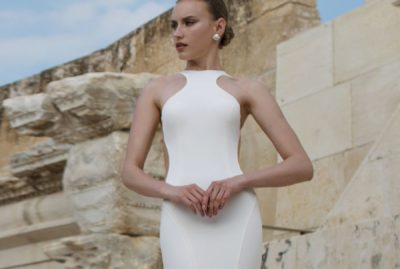 Lian Rokman - An elegant but clean gown with sophisticated cut and a daring open back